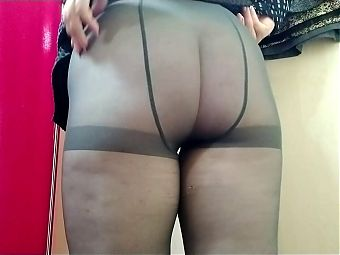 Masturbating through Pantyhose in fitting room with Buttplug