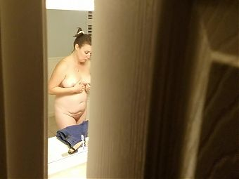 Naked wife spied in bathroom